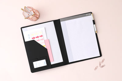 This black faux leather padfolio features a refillable tear-off sheet notepad with ample writing space and multiple storage pockets for important notes and documents, pen loop