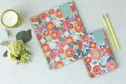 5x8 weekly monthly planner by day designer for blue sky in a floral brush design with red orange and yellow florals
