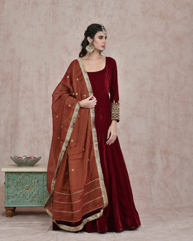 MAROON VELVET EMBROIDERED ANARKALI DRESS WITH PURE CHANDERI TISSUE DUPATTA
