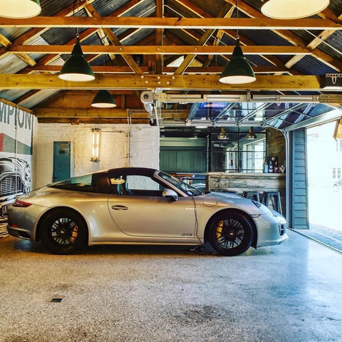 Luxury garage design with bar and vintage industrial lighting