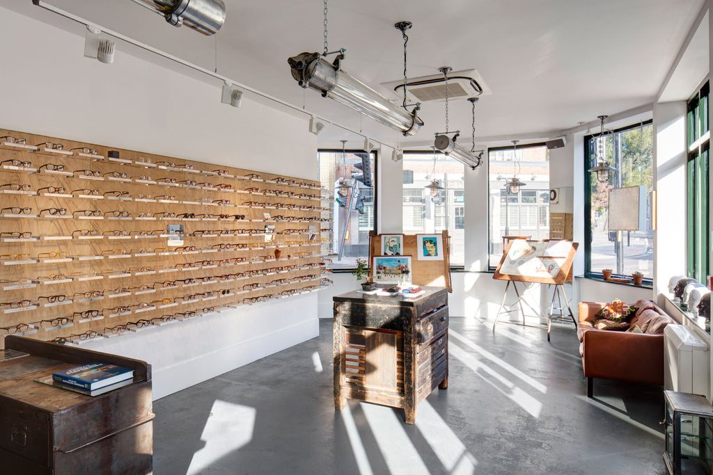 Reclaimed industrial style retail interior design with industrial aluminium & glass ceiling strip lighting
