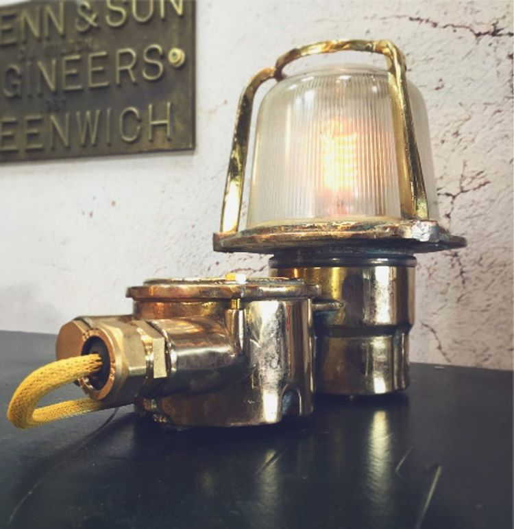 A reclaimed industrial brass table lamp converted from an old brass bulkhead lamp by EOW