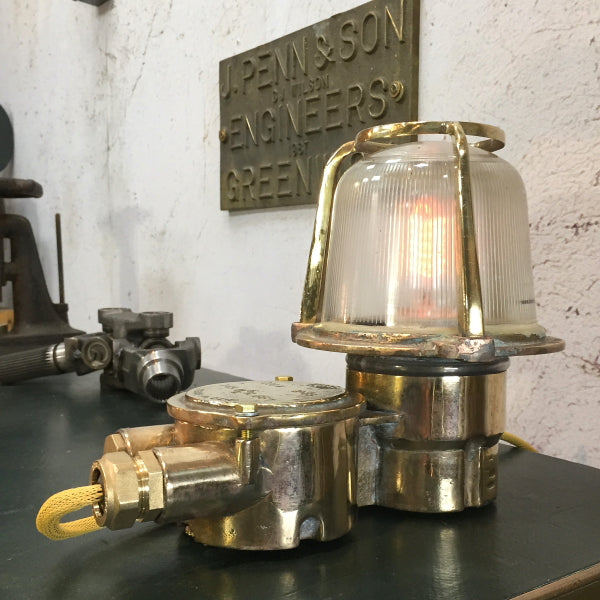 A reclaimed retro industrial brass table lamp converted from an old brass bulkhead lamp by EOW