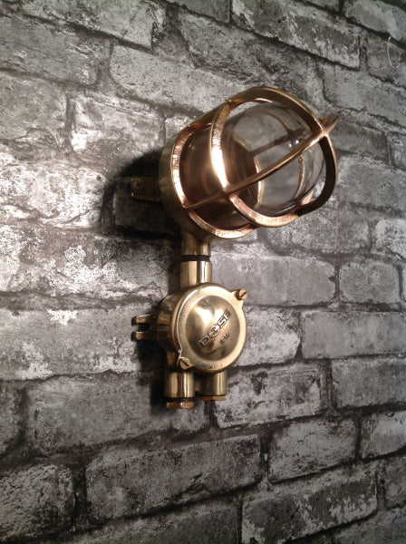 A reclaimed military brass 90 degree wall light.