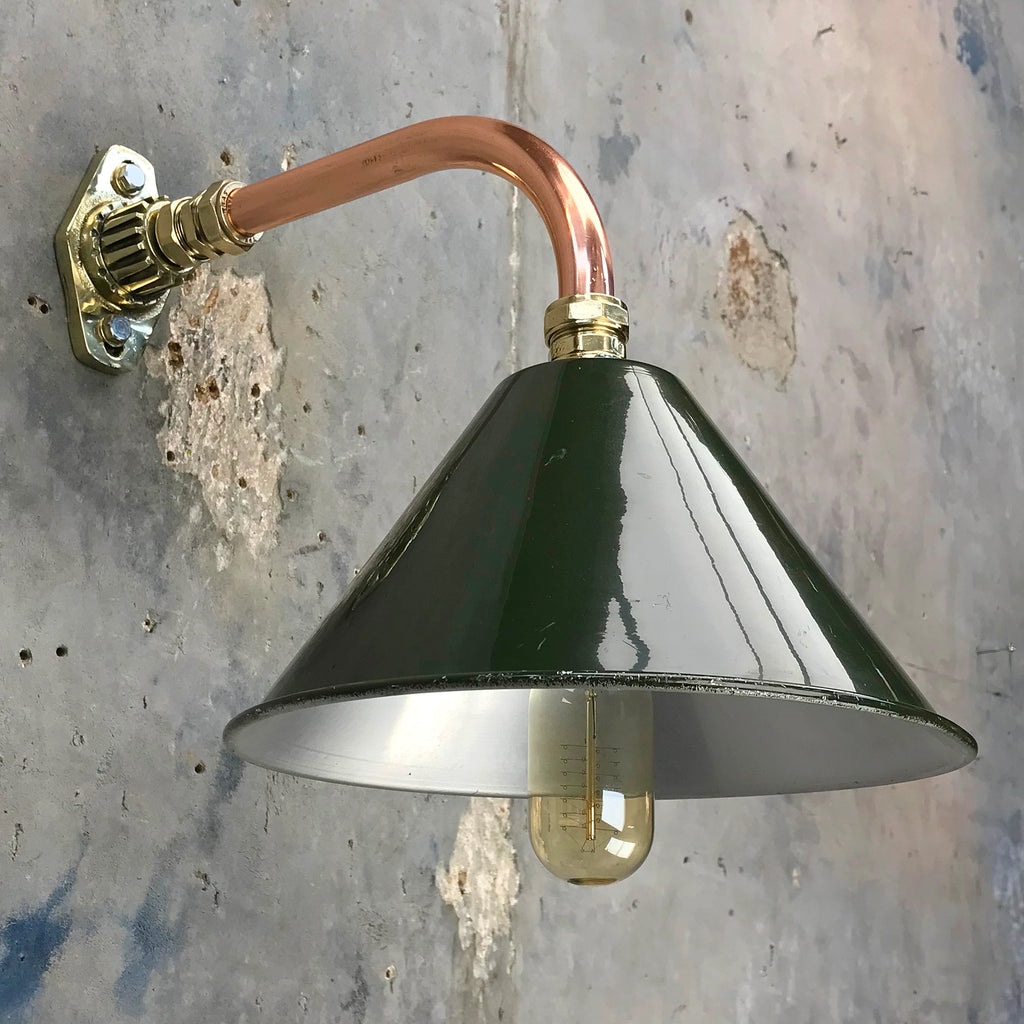 Ex British army festoon green lamp shade fitted to a copper and brass cantilever fitting.