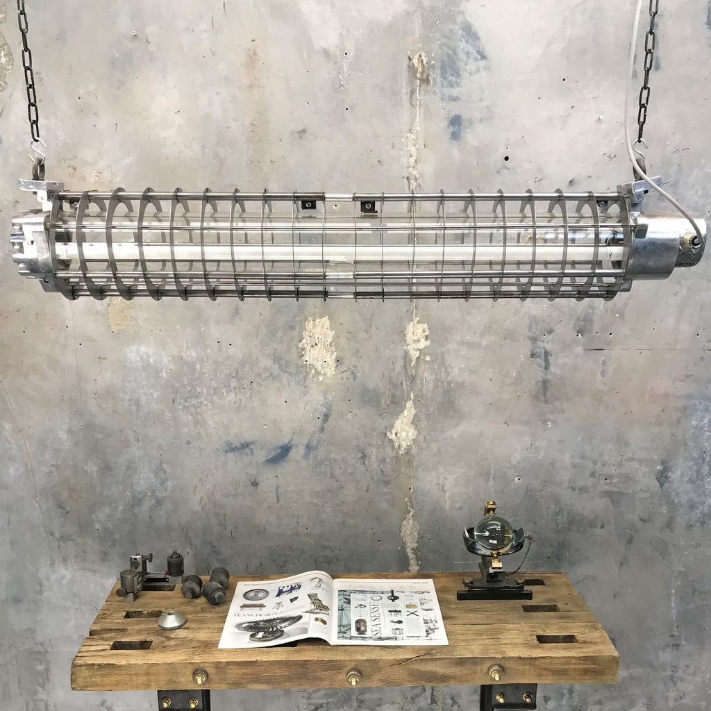 Industrial Aluminium LED Ceiling lighting. A vintage industrial 4ft German flameproof striplight with cage.