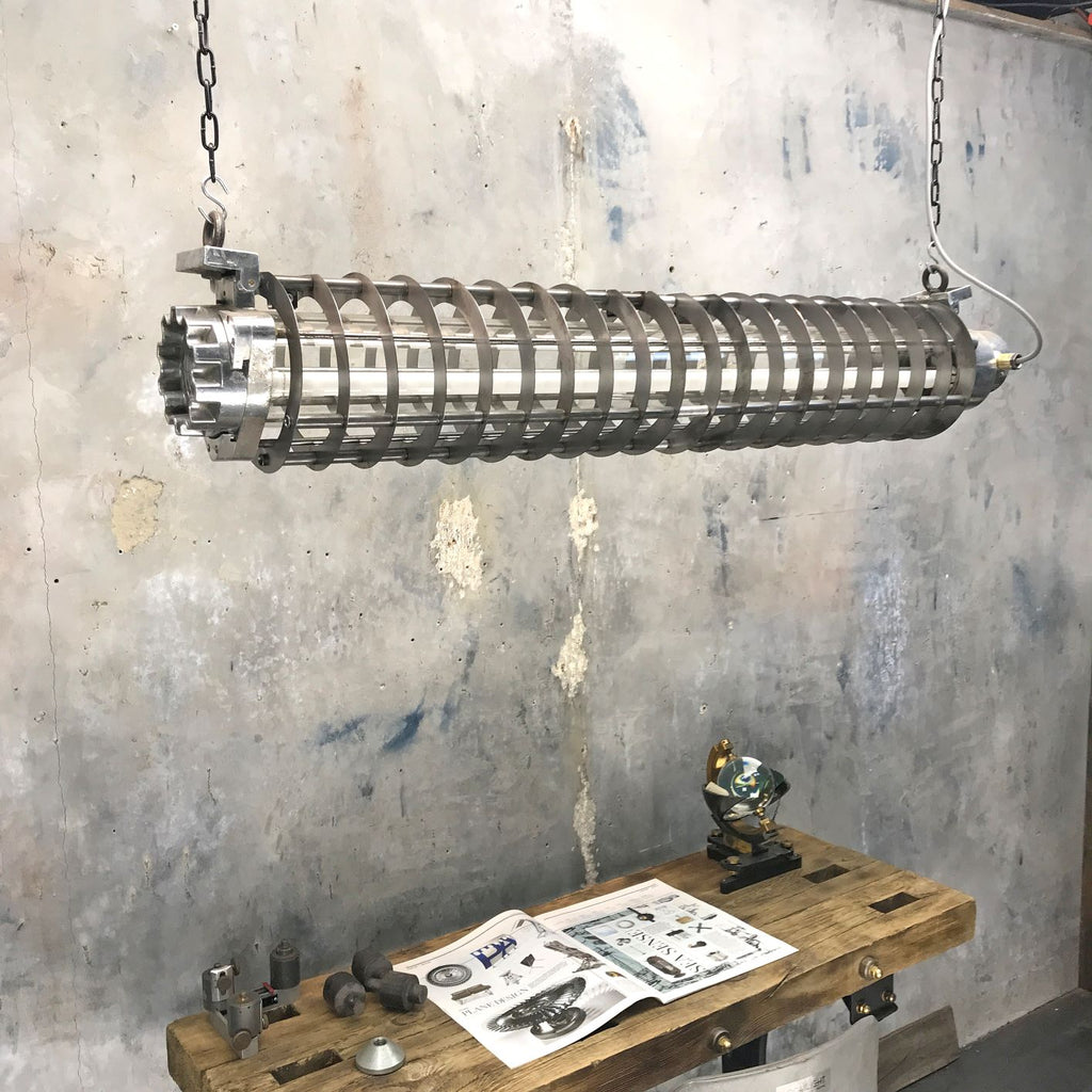 A vintage industrial 4ft German flameproof striplight with cage.