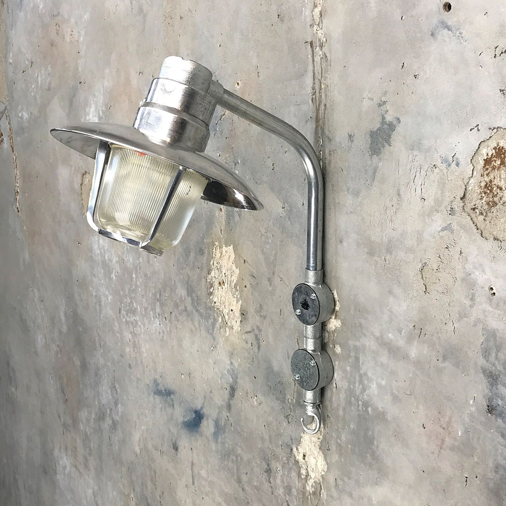 A vintage industrial aluminium swan neck outdoor wall light