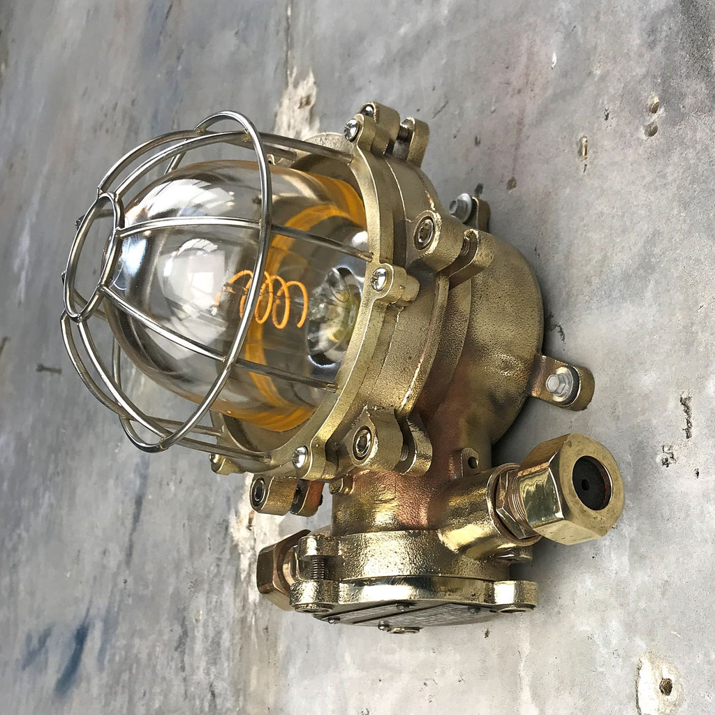 A retro industrial cast brass explosion proof bulkhead wall light made c1970.