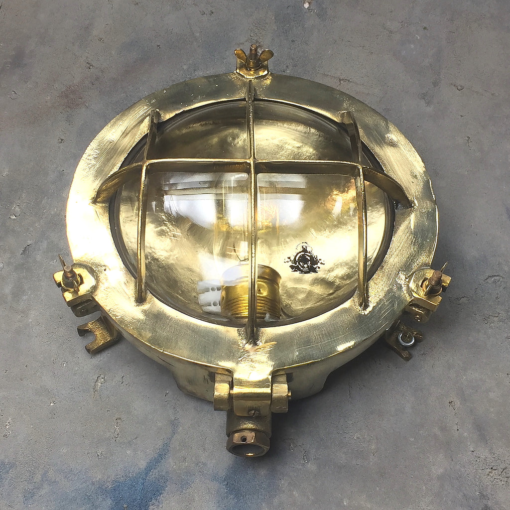 A small retro industrial circular brass bulkhead wall lighting by Wiska.
