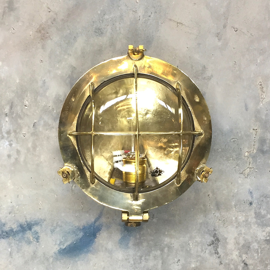 Vintage industrial circular brass bulkhead wall lighting by Wiska.