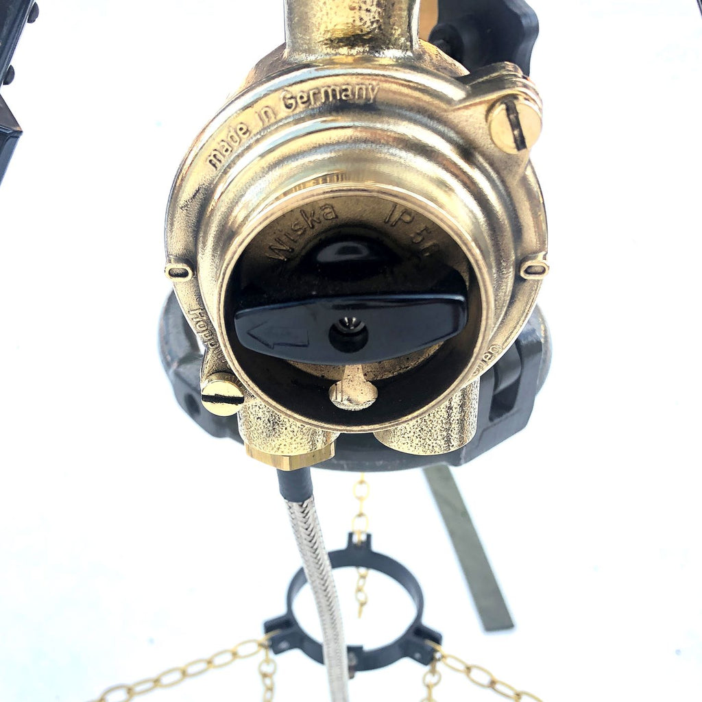 A reclaimed retro industrial British brass searchlight with a Russian military gyroscope tripod.