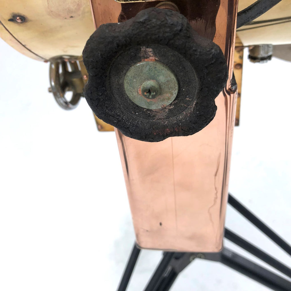 A reclaimed industrial 1980's copper and brass searchlight coupled with military tripod bespoke floor lamp