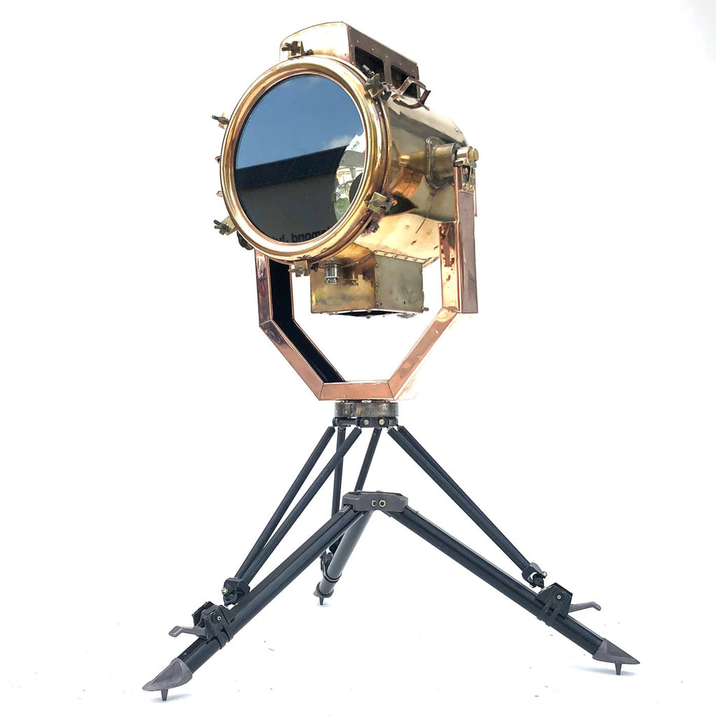 A reclaimed industrial 1980's copper and brass searchlight coupled with military tripod