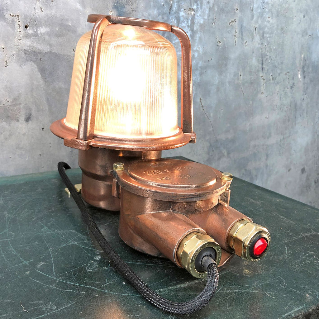 A reclaimed industrial 1970's copper and brass table lamp converted from an old bulkhead lamp by EOW.