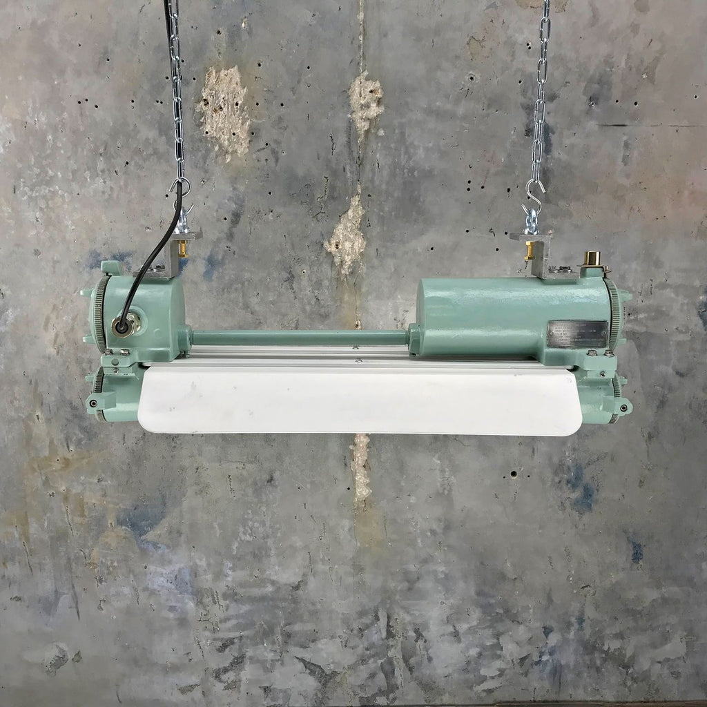 Retro industrial ceiling striplight painted duck egg green with energy saving LED tubes.