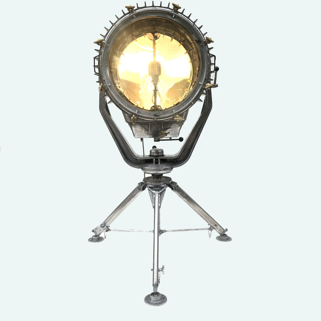 A reclaimed retro industrial aluminium marine searchlight paired with a satellite tripod to create a large bespoke floor lamp.