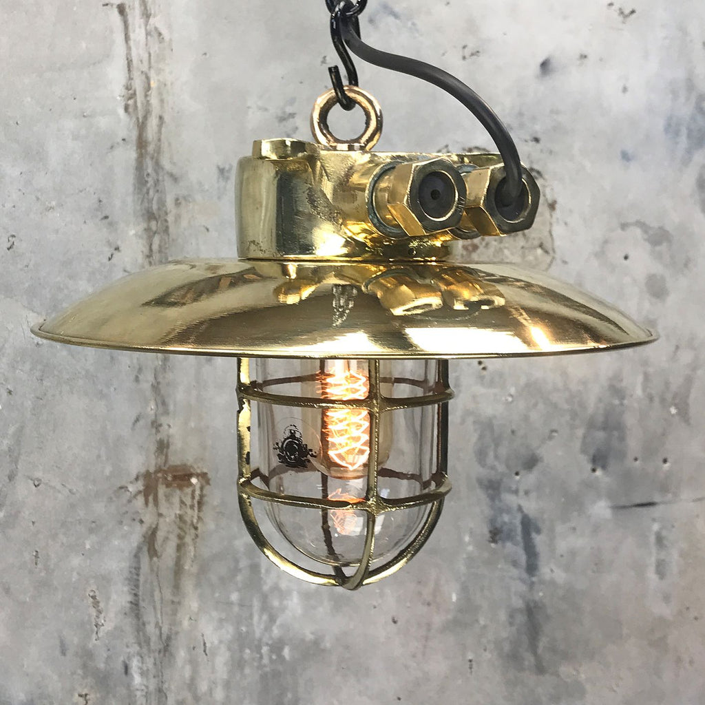 Explosion proof brass cage light. Reclaimed industrial lighting