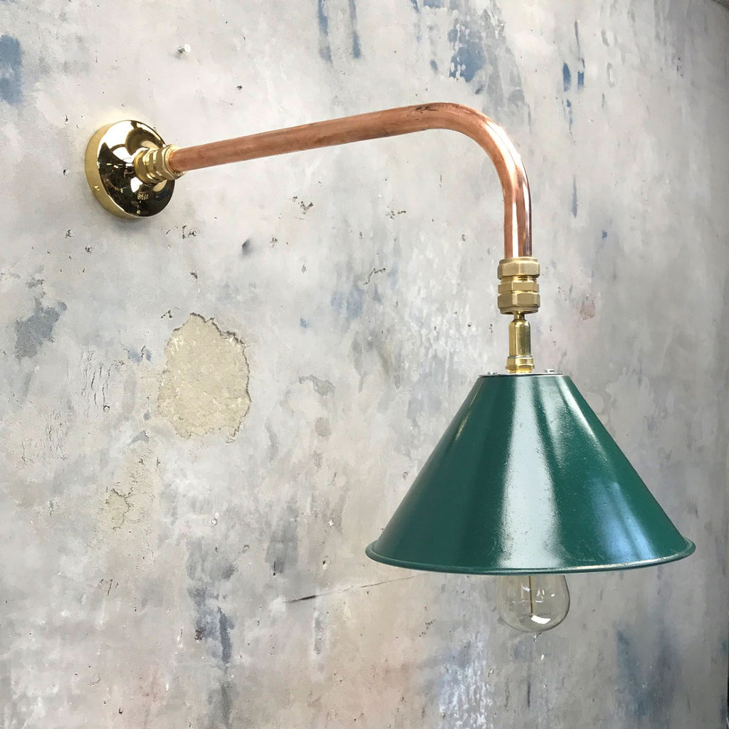 Vintage British army tilting festoon lamp shade fitted to a bespoke copper and brass cantilever wall fitting.
