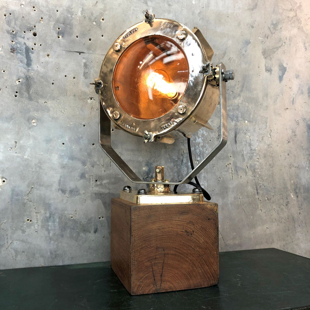 A unique vintage bronze and teak industrial desk lamp.