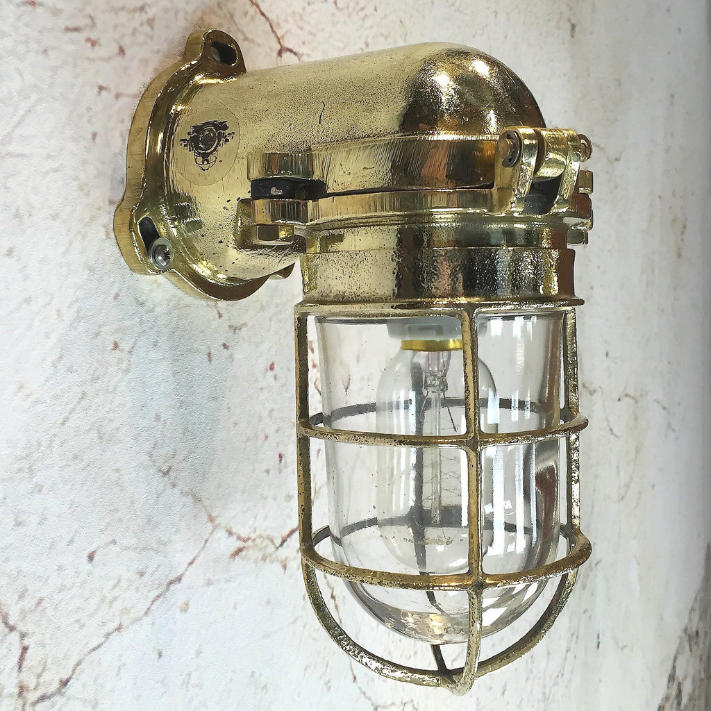 A Japanese industrial brass 90 degree wall light with cage
