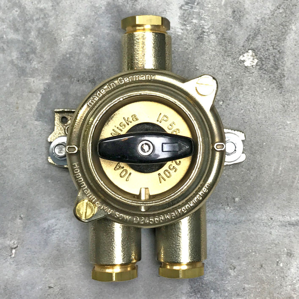 A vintage industrial brass light switch by Wiska with 3 entry ports. Original & reclaimed HNA Rotary isolator switch