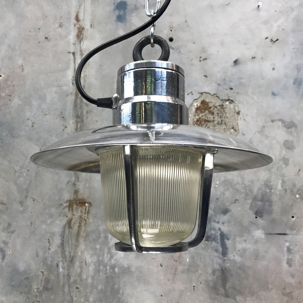 A vintage aluminium nautical ceiling pendant with prismatic glass shade by EOW.