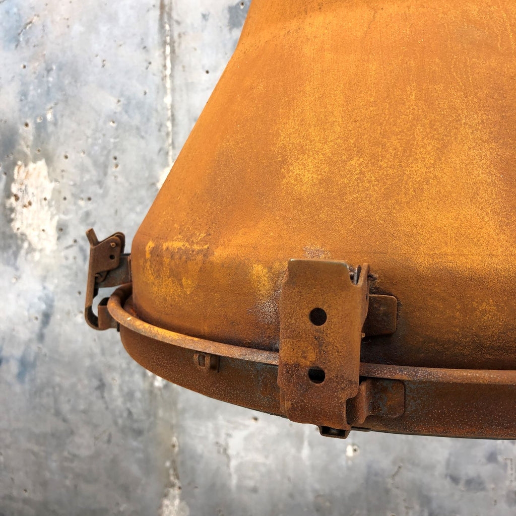 A vintage industrial conical ceiling light with applied rust finish by Korean manufacturer Daeyang.