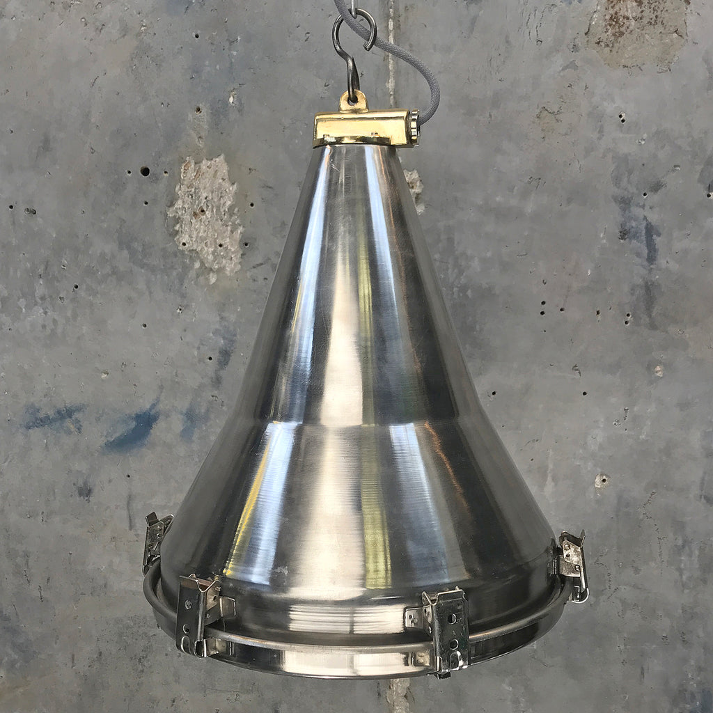 A reclaimed stainless steel industrial flood light ceiling pendant