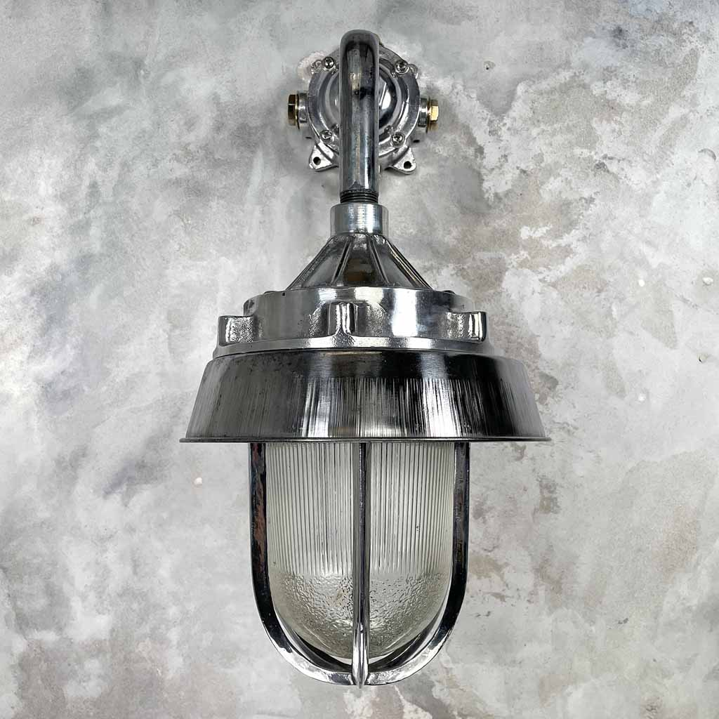 Large vintage aluminium 90 degree wall lighting with soft diffusion glass dome and protective cage.