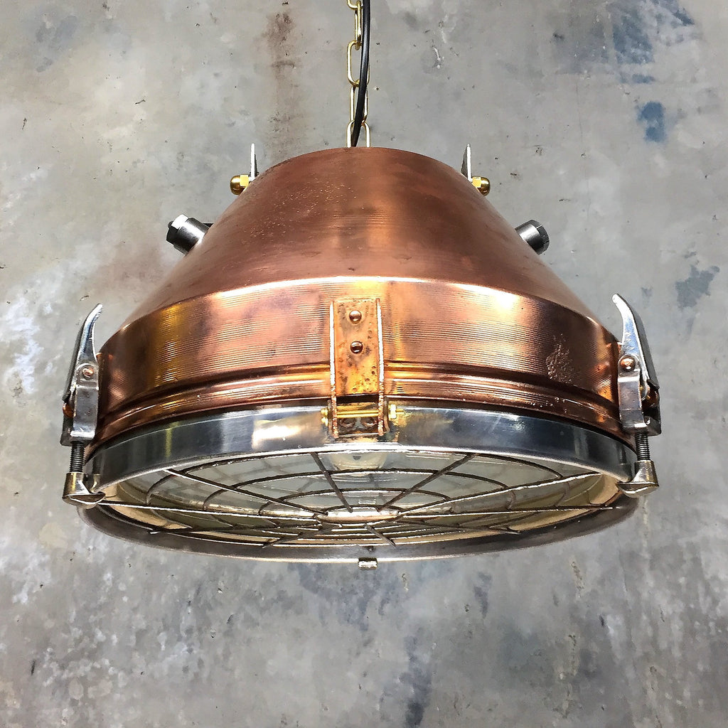 A German vintage copper ceiling pendant with a protective target grill