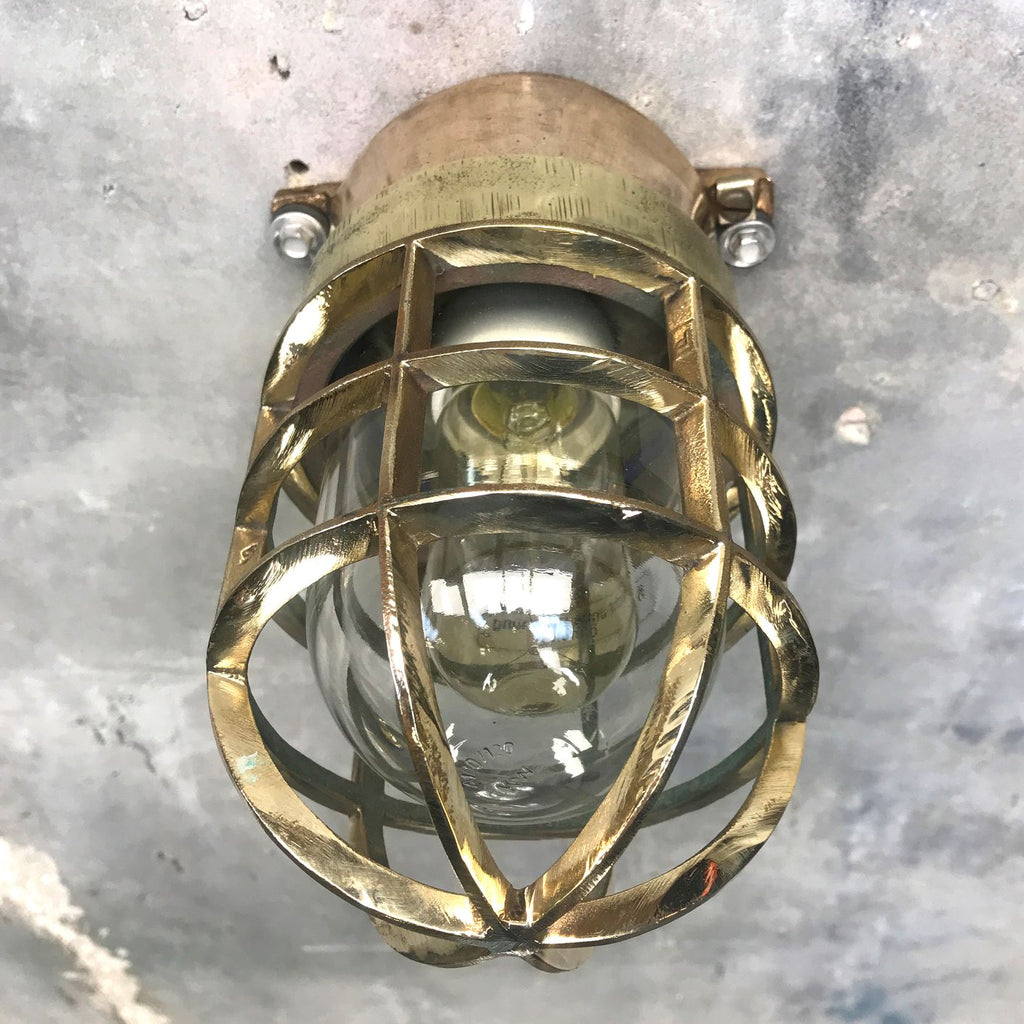 A vintage industrial bronze and brass wall cage light fixture by Wiska.