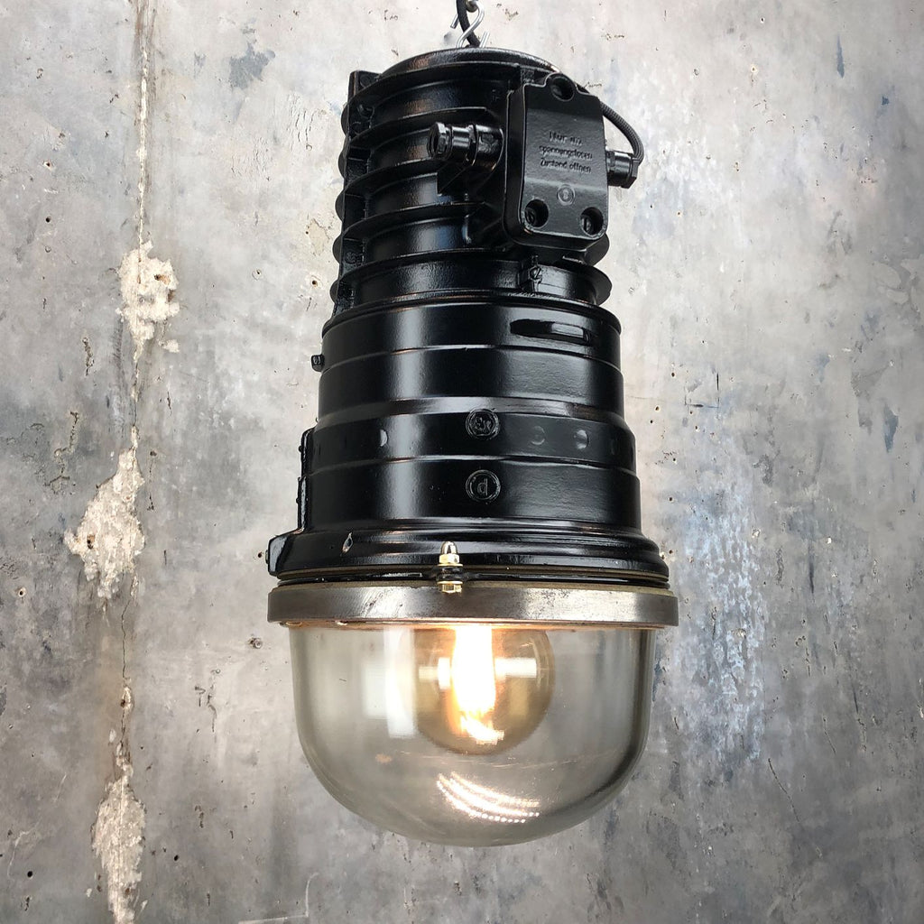 A vintage industrial black explosion proof ceiling pendant by EOW fitted with energy saving LED light bulb.