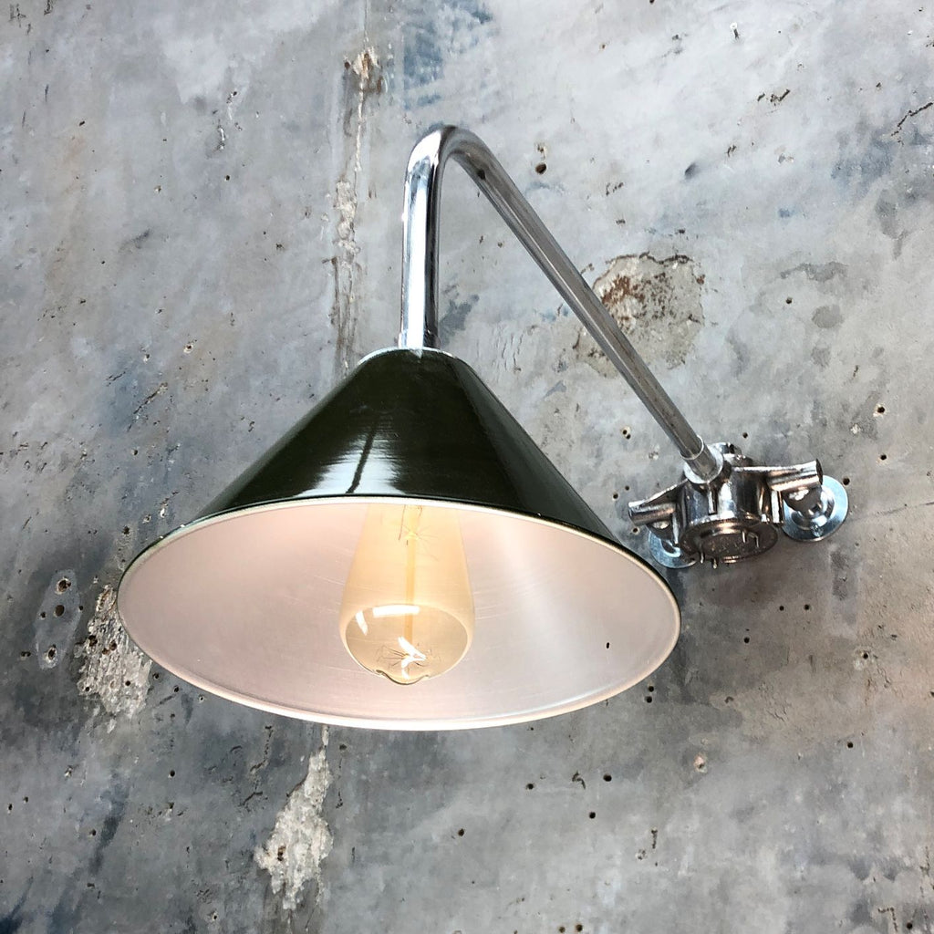 Reclaimed British army lamp shade on galvanised cantilever wall fixing.