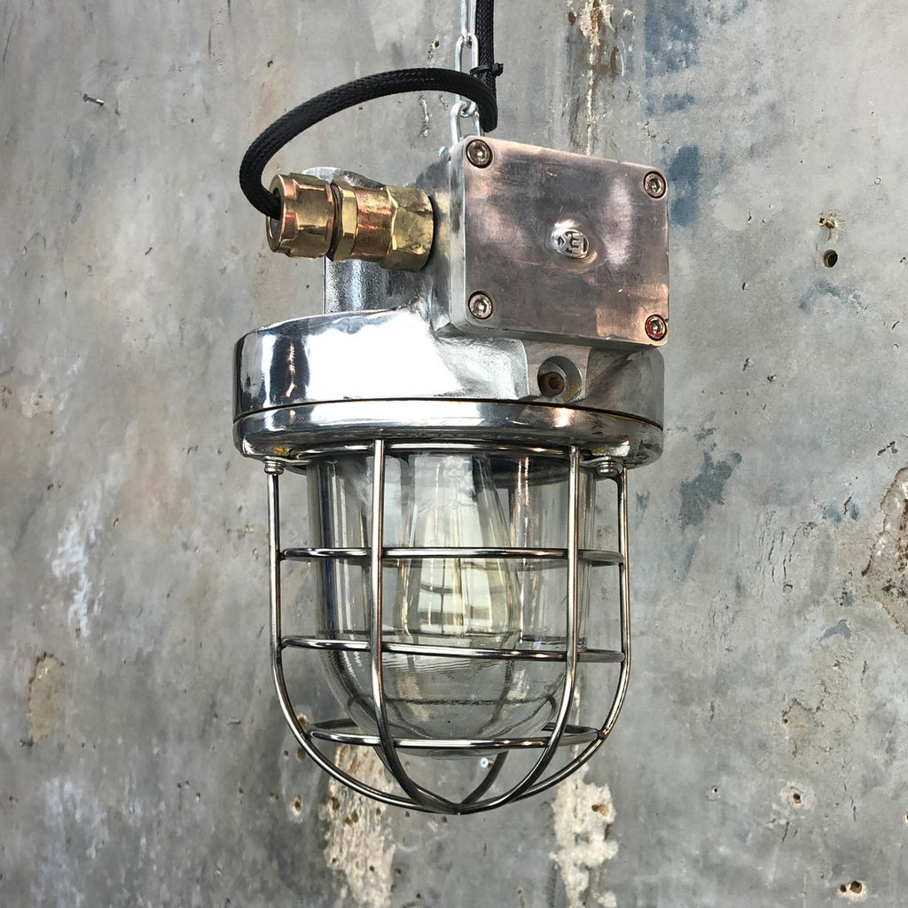 A late century  industrial cast aluminum ceiling light with explosion proof glass dome and cage by Kukdong Elecom
