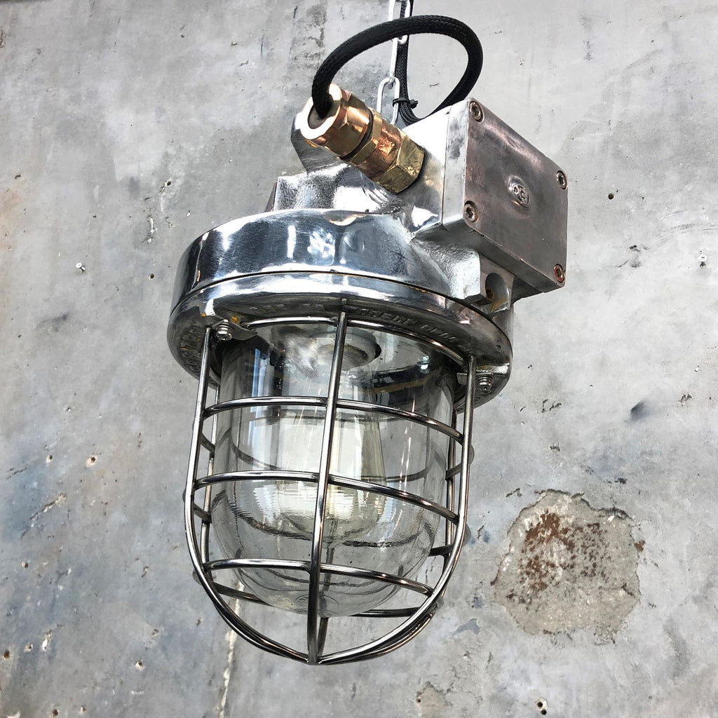 A late century Korean industrial cast aluminum ceiling pendant with explosion proof glass dome and cage by Kukdong Elecom