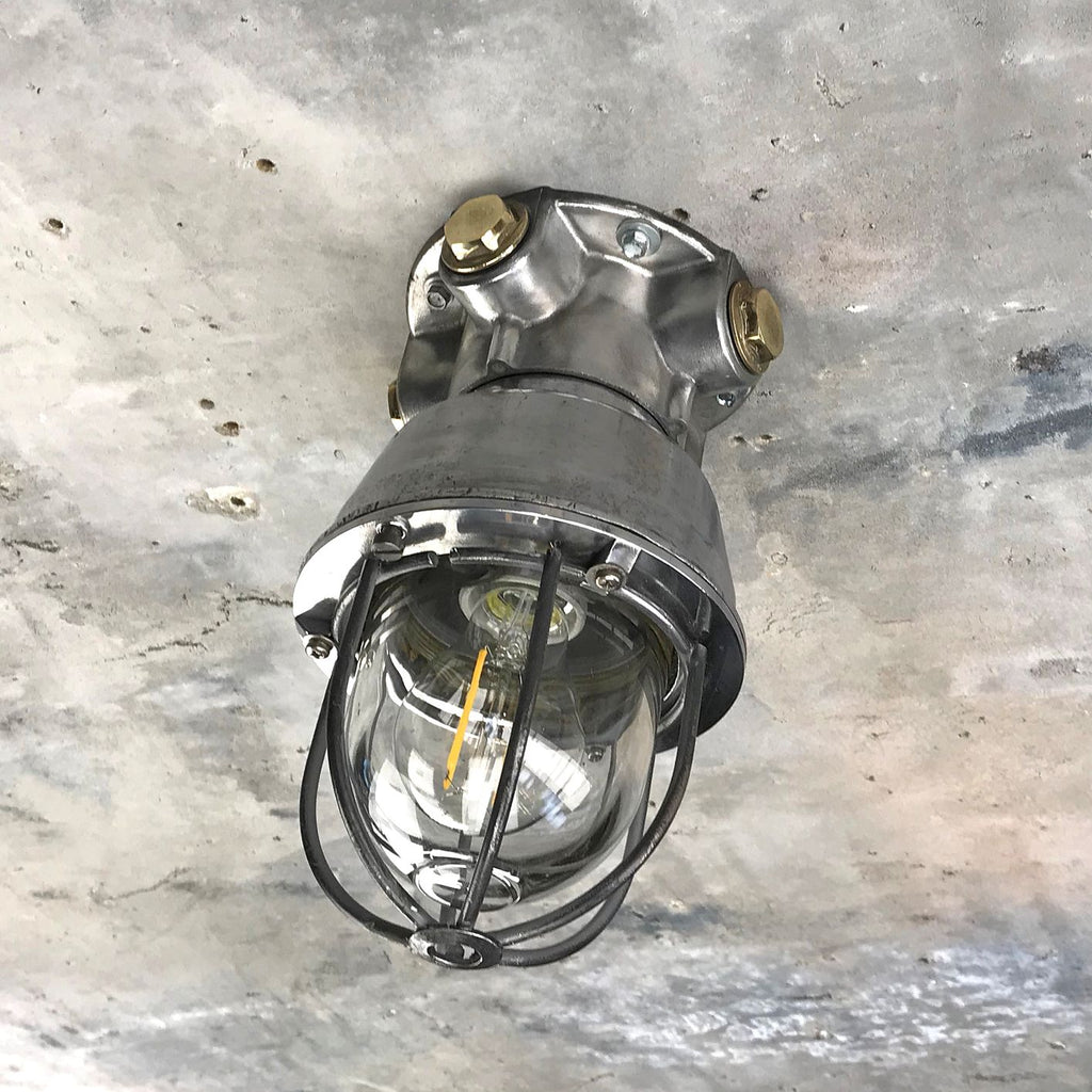 A vintage industrial Italian explosion proof surface mounted ceiling cage light.