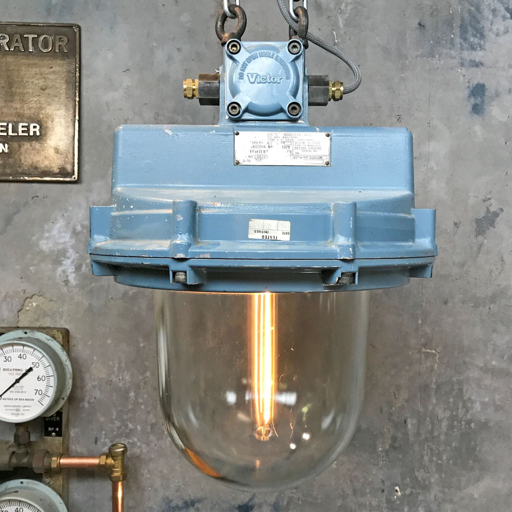 A large blue mid century vintage industrial ceiling light pendant by Victor with protective glass dome.