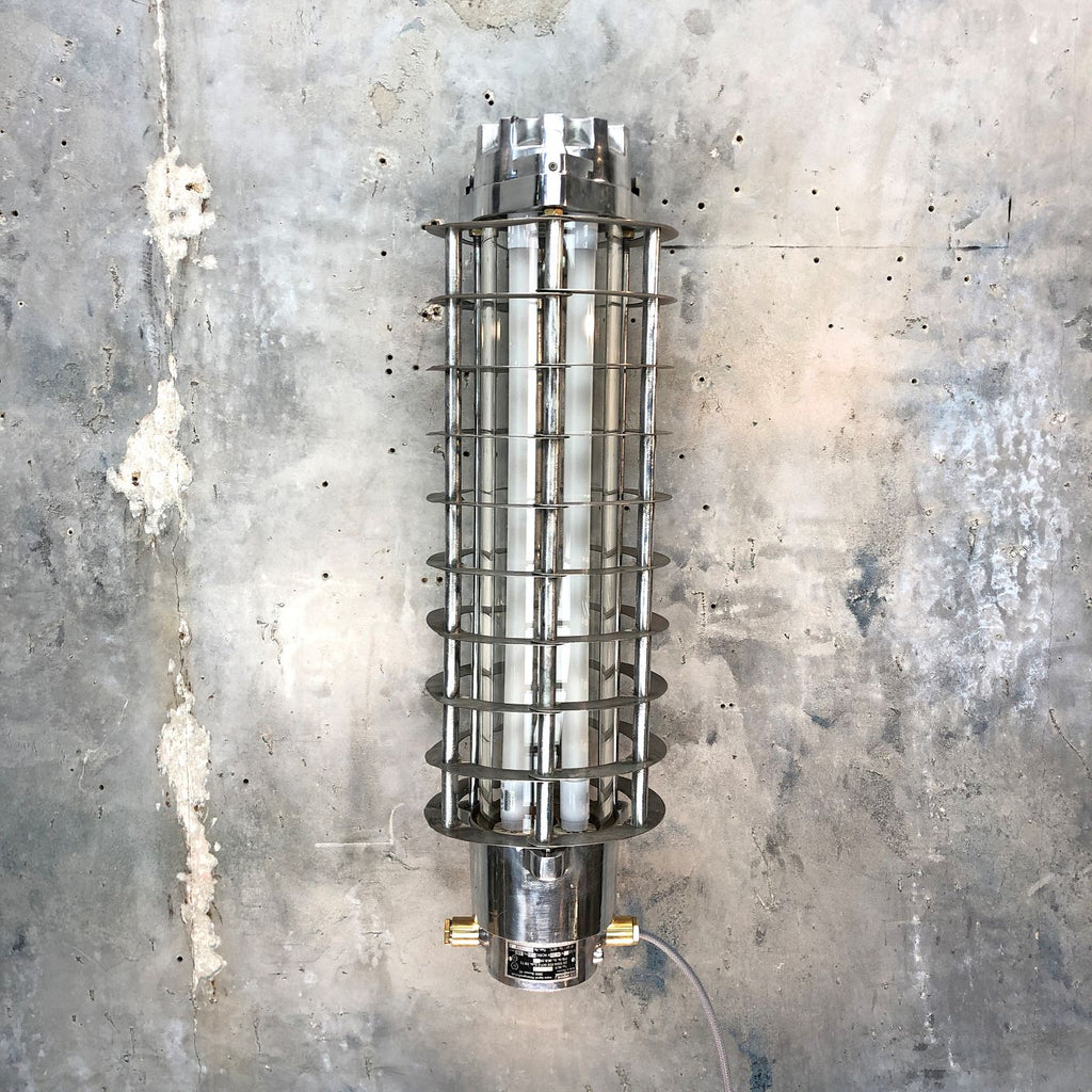 A retro Industrial aluminum wall-mounted flameproof striplight with protective cage by Wittenberg.
