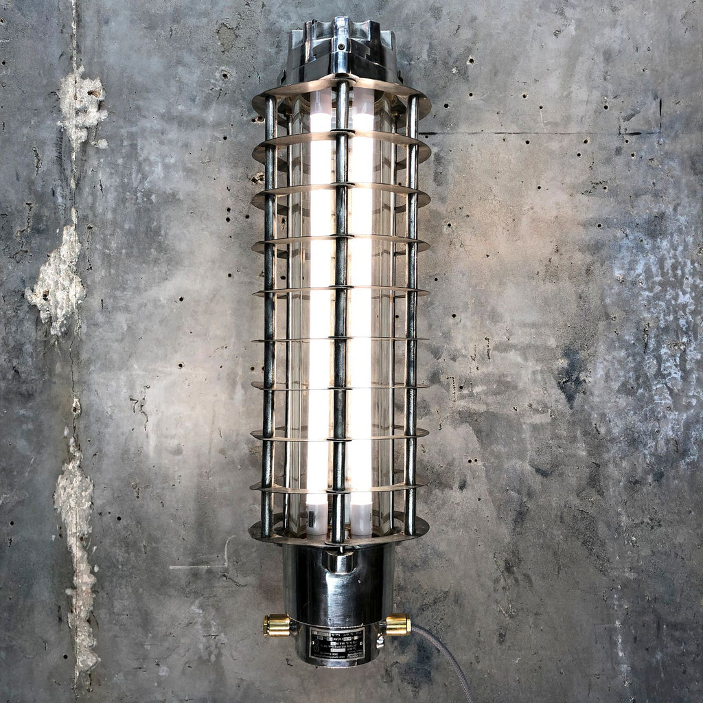A vintage industrial aluminum wall-mounted flameproof striplight with protective cage by Wittenberg
