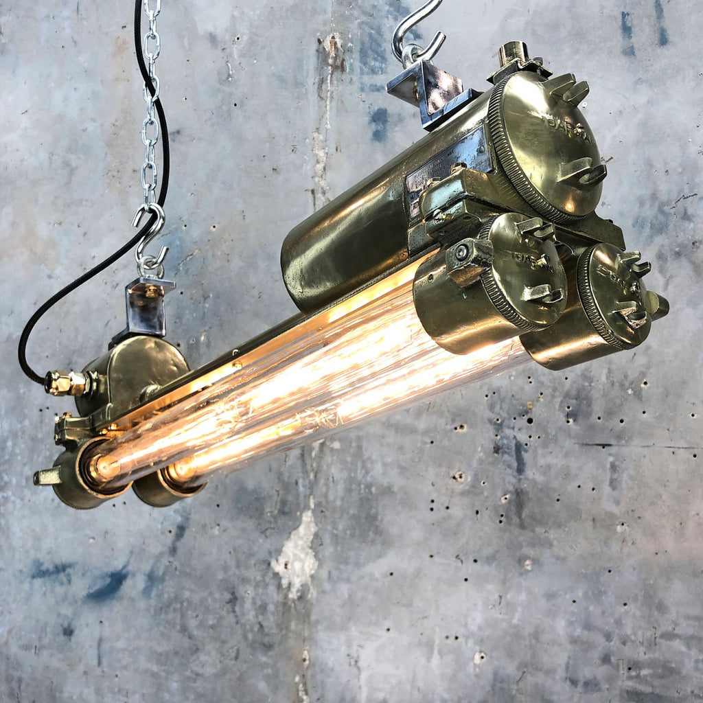 A vintage industrial brass ceiling flameproof tube light fitted with Edison LED tubes.