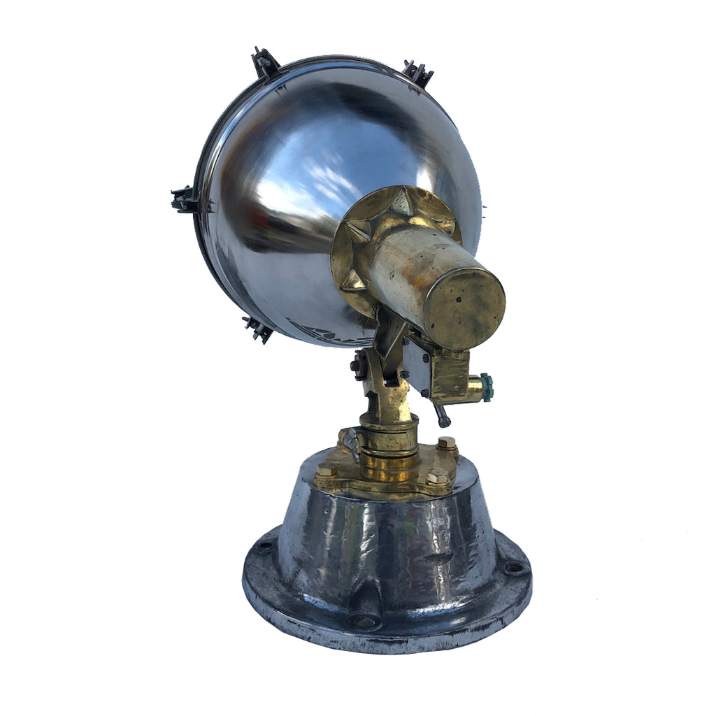 A vintage industrial stainless steel, cast brass & bronze searchlight floor lamp.
