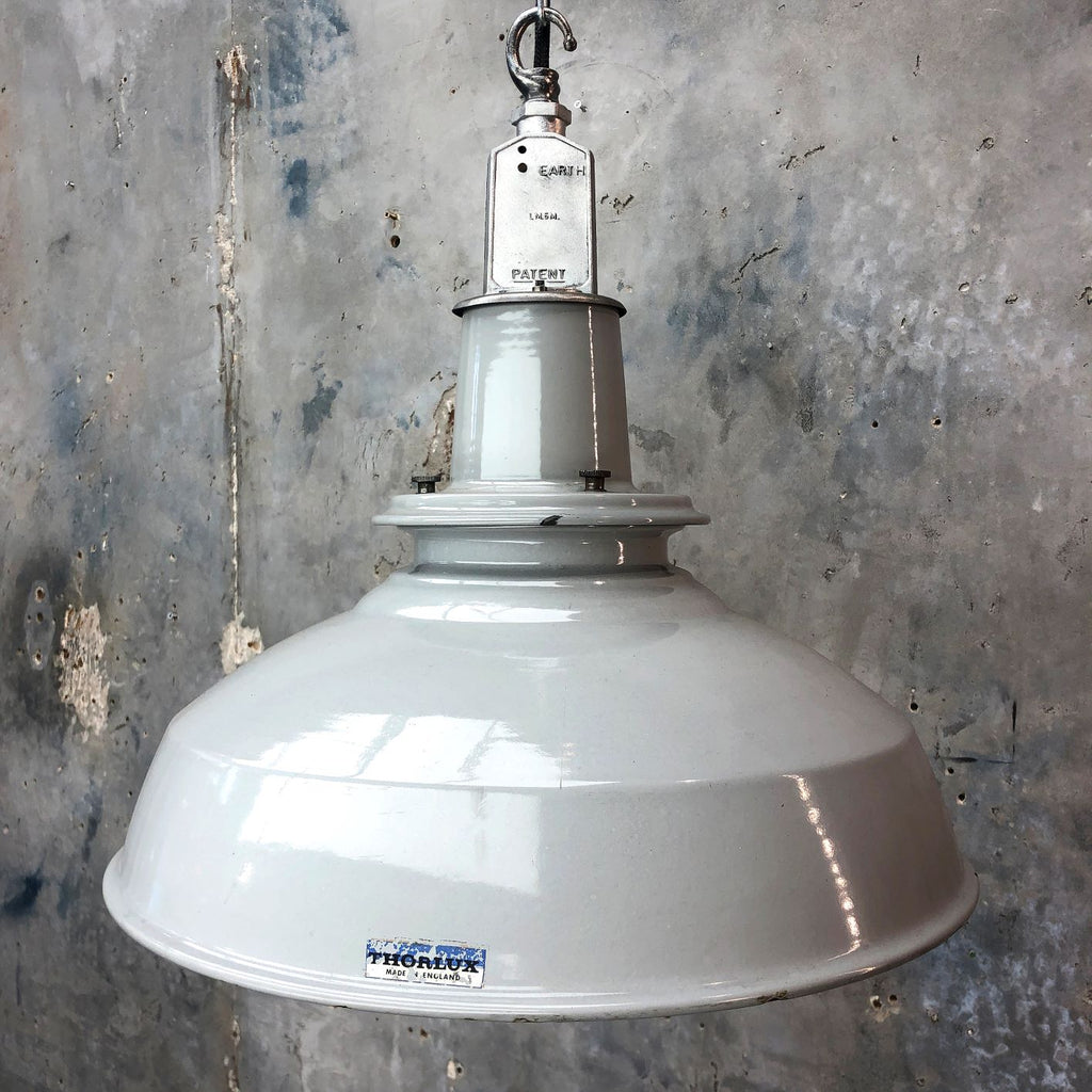 A British mid century grey enamel ceiling factory light by Thorlux.