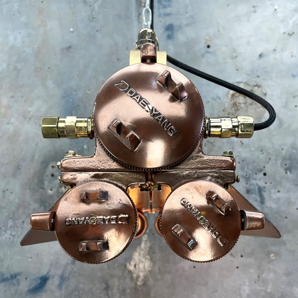 Vintage industrial copper flameproof Edison tube ceiling strip light with shades made by Daeyang in the 1970's