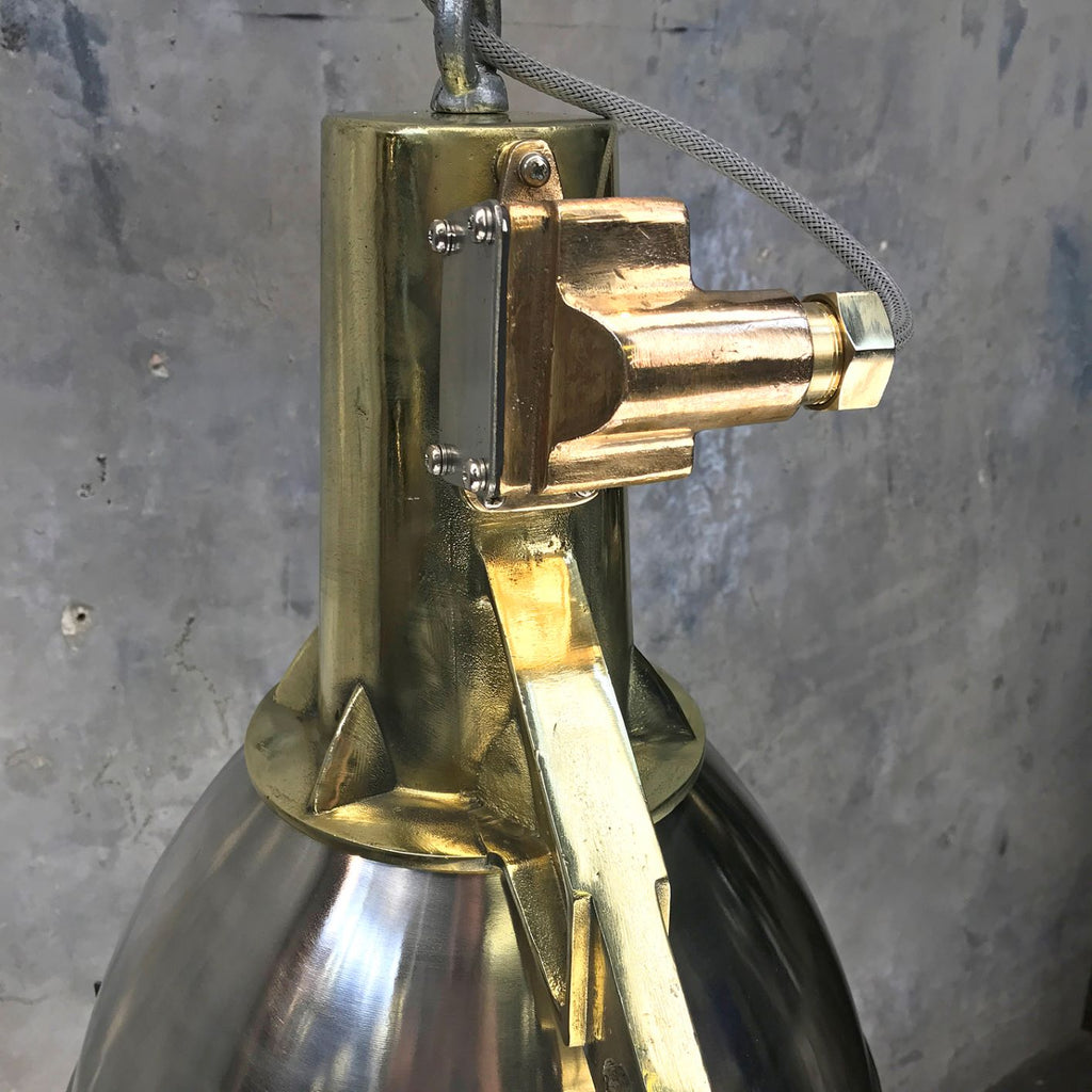A vintage industrial large stainless steel and cast brass searchlight ceiling pendant conversion.