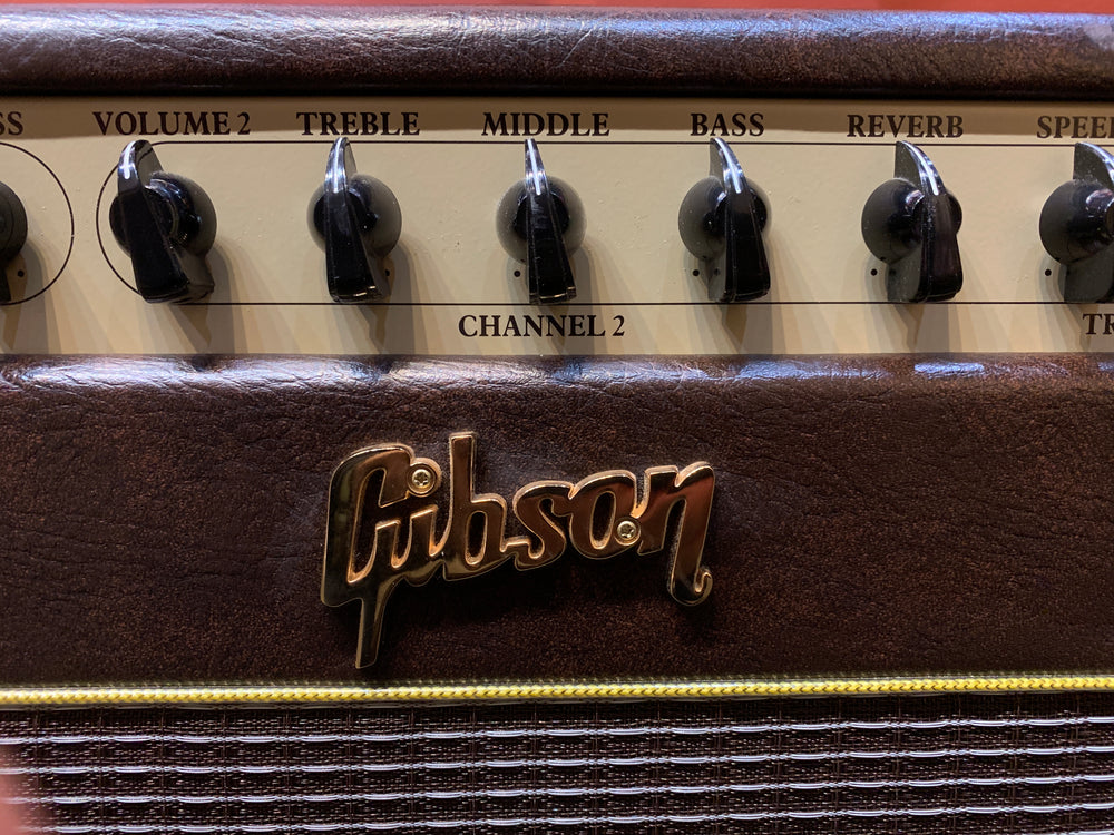 "This Gibson GA-20RVT is hand built with point to point wiring and a hand-wired turret board. The pentode/triode switch gives you nice distortion at half the power for a huge tone at low volume. There are 2 Channels plus a Mix Channel making it an incredibly versatile amp, perfect for the studio and the gig. It comes stock with a 12"" Eminence Legend Speaker that is perfectly voiced and balanced. The two-tone tolex gives it a classic look to match it's classic sound!"