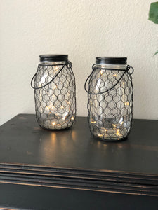 Two Lighted Jars