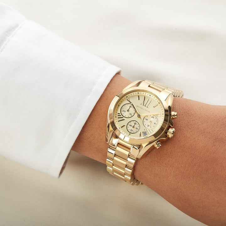 Michael Kors Bradshaw Chronograph Champagne Dial Ladies Watch MK5798 Water resistance: 100 meters / 330 feet Movement: Quartz