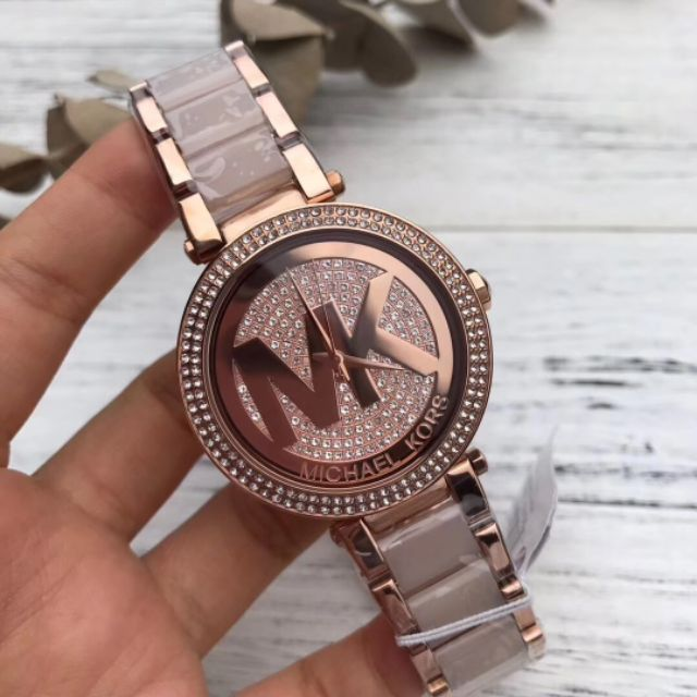 Michael Kors Parker Crystal Pave Logo Dial Ladies Watch MK6176 Water resistance: 100 meters / 330 feet Movement: Quartz