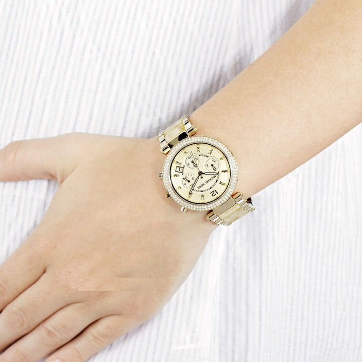 Michael Kors Parker Chronograph Champagne Dial Ladies Watch MK5632 Water resistance: 30 meters / 100 feet Movement: Quartz